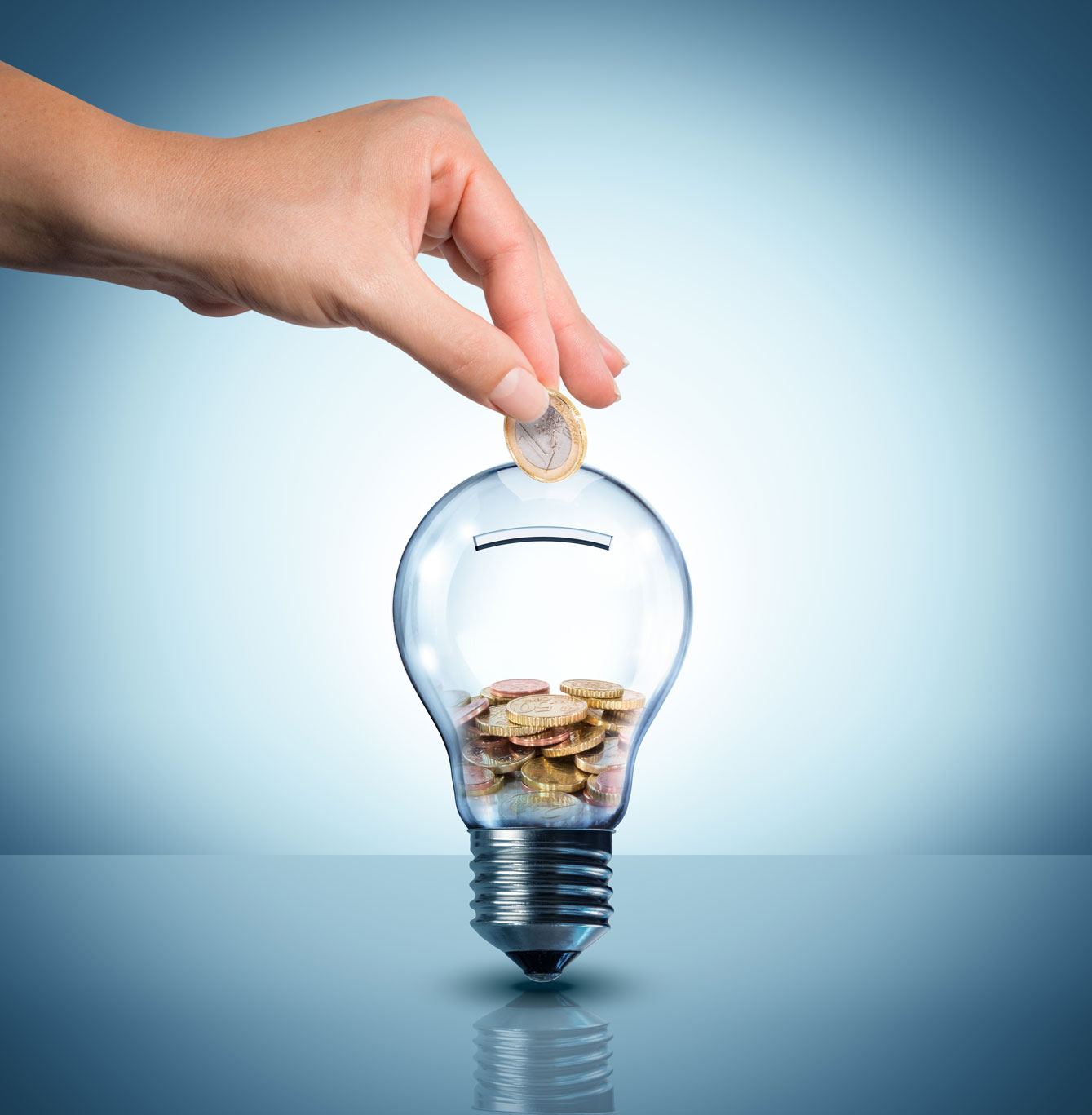 energy saving tips shows hand putting coin in lightbulb