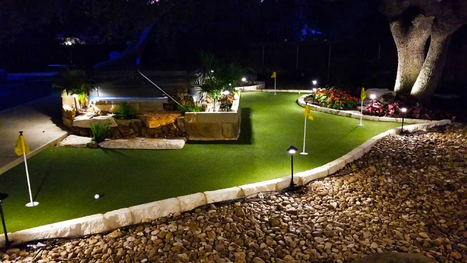 Synlawn artificial turf Precision Putt putting green at night in Austin Texas installed by Speir Grass